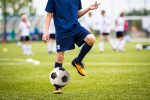 head strikes in soccer | ALS News Today | person playing soccer